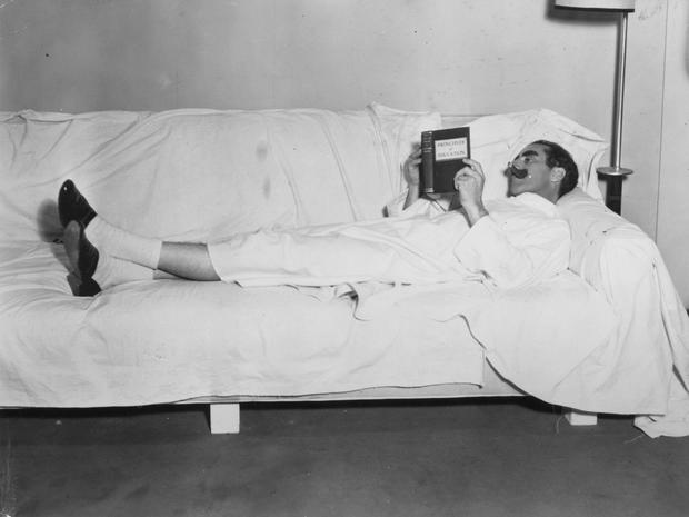 Man's best friend: American comic genius Groucho Marx reads 'Principals of Education' during a break in the filming of 'Duck Soup'. Photo: Hulton Archive/Getty Images