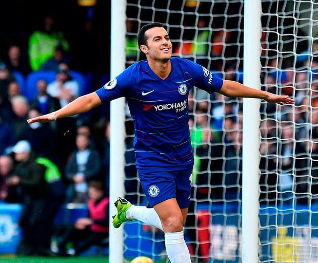 Chelsea's Pedro wheels away to celebrate after opening the scoring. Photo: Glyn Kirk/AFP/Getty Images