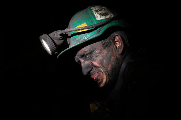 Dirty job: A miner finishes his shift covered in coal dust at the KWK Pniowek coal mine in Pawlowice – Poland still gets 80pc of its power from coal. Photo: Sean Gallup/Getty Images