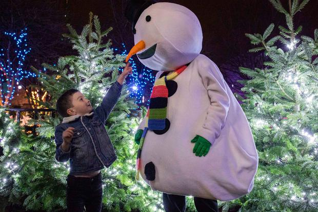 Let it snow: Alex O'Brien of Carrigaline, Co Cork, met 'Frosty' at Cork's Glow Christmas celebration, which runs every weekend until December 22. Photo: Clare Keogh