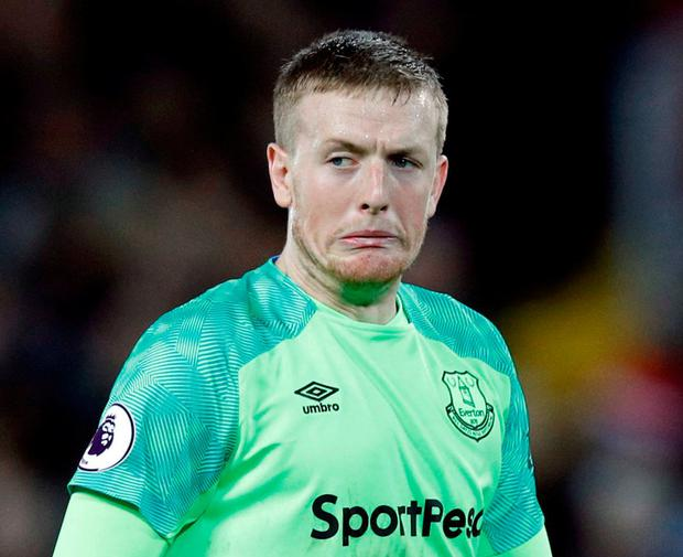 In a pickle: Jordan Pickford can't hold back the tears after his injury-time howler gifted the winner to Divock Origi. Photo: Phil Noble/Reuters