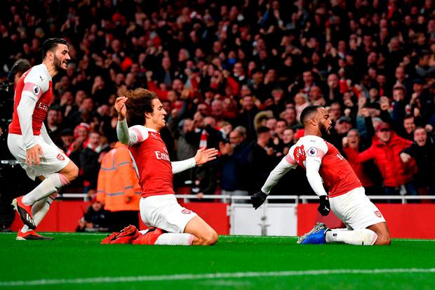Top guns: Alexandre Lacazette (R) of Arsenal celebrates with teammates after scoring his team's third goal against Tottenham. Photo: Shaun Botterill/Getty Images