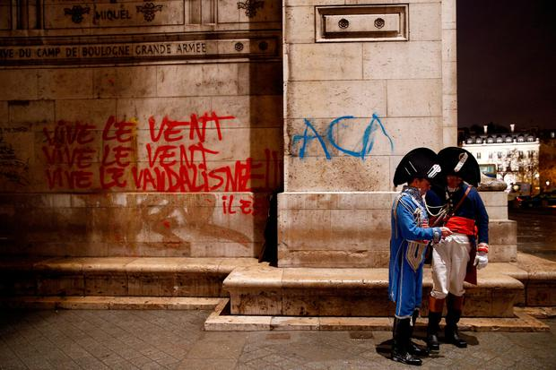 The Arc de Triomphe was daubed with graffiti during the latest unrest. Photo: REUTERS/Stephane Mahe