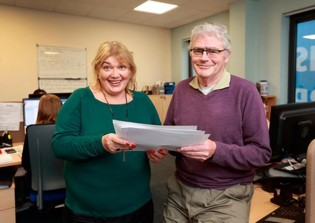 Help is at hand: Linda Kenny, team leader at the St Vincent de Paul call centre in Dublin, and volunteer Andy Russell. PHOTO: Frank McGrath