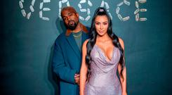 Kanye West and Kim Kardashian West attend the the Versace fall 2019 fashion show at the American Stock Exchange Building in lower Manhattan on December 02, 2018 in New York City. (Photo by Roy Rochlin/Getty Images)