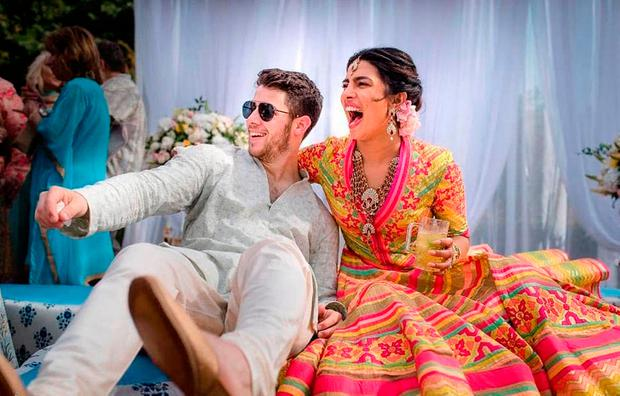 Bollywood actress Priyanka Chopra and Nick Jonas celebrate during a mehendi ceremony, a day before their wedding, at Umaid Bhawan in Jodhpur, India. (Raindrop Media via AP)