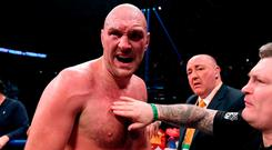 Tyson Fury celebrates at the end of the 12th round fighting to a draw with Deontay Wilder during the WBC Heavyweight Champioinship at Staples Center on December 1, 2018 in Los Angeles, California. (Photo by Harry How/Getty Images)
