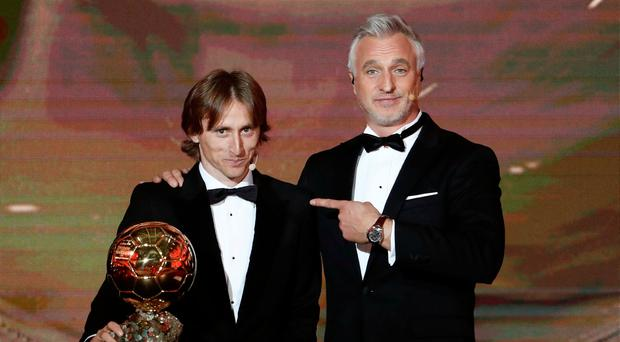 Soccer Football - 63rd Ballon d'Or - The Grand Palais, Paris, France - December 3, 2018 David Ginola and Real Madrid's Luka Modric with the Ballon d'Or award REUTERS/Benoit Tessier