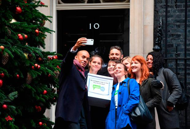 In focus: Labour MP Chuka Umunna takes a selfie while handing in Final Say and People's Vote petitions – both of which call for the public to be given a chance to reject the final Brexit deal in favour of staying in the EU – to 10 Downing Street. Photo: PA Wire