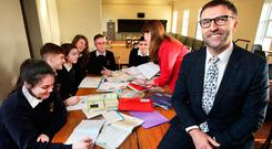 Learning: Tom Lowry, principal, and Irish teacher and study co-ordinator Lorraine Smyth with one of the after-school study groups. Photo: Steve Humphreys