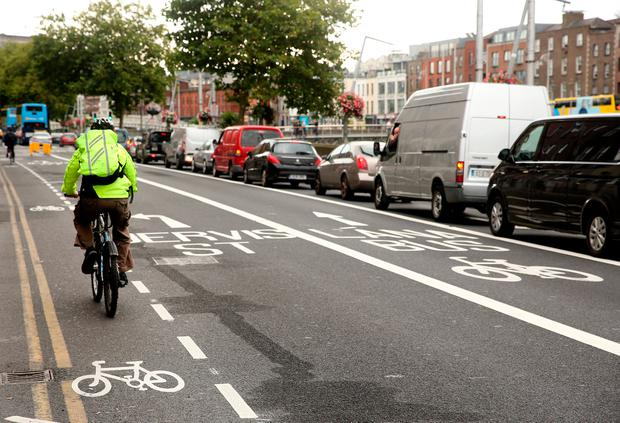 A cyclist makes his way along the North Quays in Dublin. Photo: Gerry Mooney