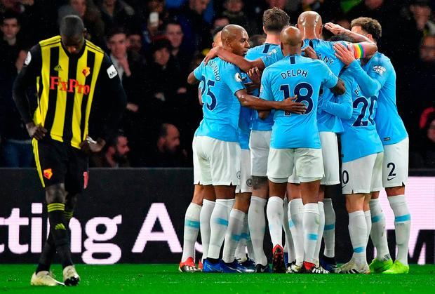 Manchester City's German midfielder Leroy Sane is mobbed by teammates after scoring the opening goal during the English Premier League football match between Watford and Manchester City at Vicarage Road Stadium in Watford, north of London on December 4, 2018. (Photo by Ben STANSALL / AFP)
