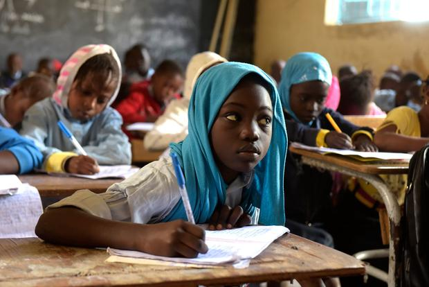 Keen to learn: Pupils at a primary school in Pikine, Dakar, Senegal. Photo: SEYLLOU/AFP/Getty Images