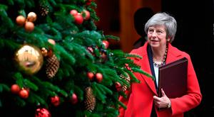 Christmas wish: Mrs May leaves No10 on her way to parliament Photo: PA