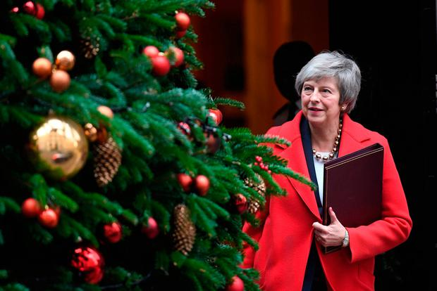 Christmas wish: Mrs May leaves No 10 on her way to parliament Photo: PA