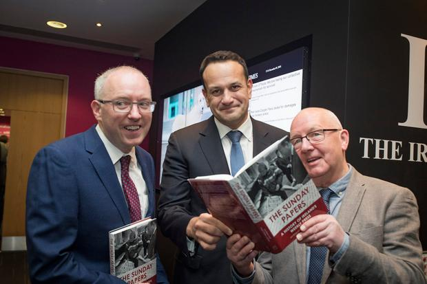 Brought to book: Taoiseach Leo Varadkar with authors Mark O'Brien (left) and Joe Breen at the launch of 'The Sunday Papers'. Photo: Arthur Carron
