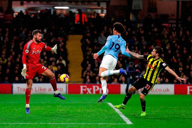 Leroy Sane of Manchester City scores his team's first goal. Photo: Richard Heathcote/Getty Images