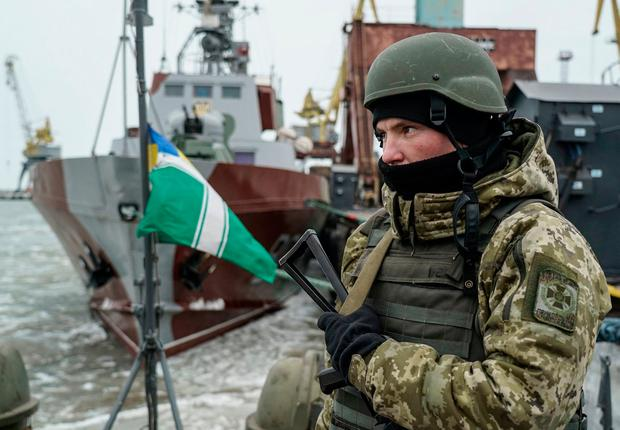 A Ukrainian serviceman stands on board a coast guard ship in the Sea of Azov port of Mariupol, eastern Ukraine. AP Photo/Evgeniy Maloletka