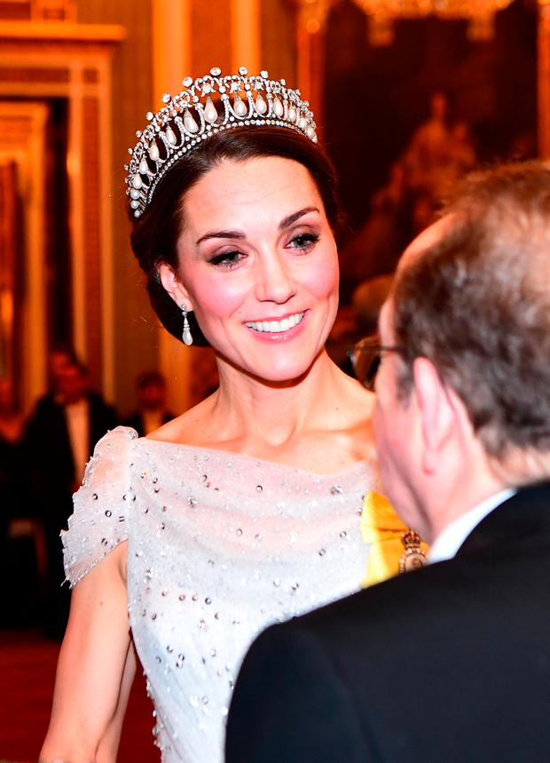 Britain's Catherine, The Duchess of Cambridge, talks to guests at an evening reception for members of the Diplomatic Corps at Buckingham Palace in London, Britain December 4, 2018. Victoria Jones/Pool via REUTERS