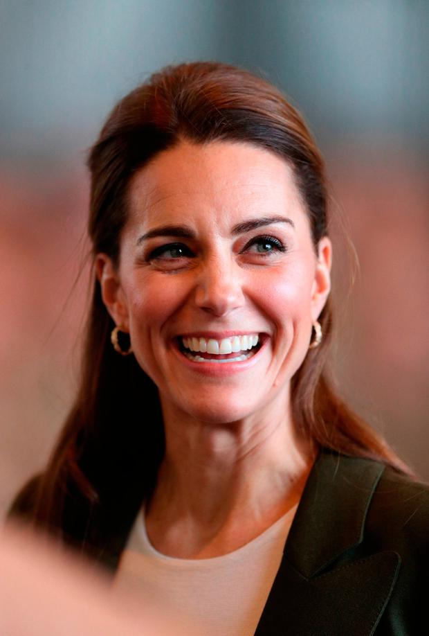The Duchess of Cambridge meets members of 31 SQN and other operational personnel in a hangar at RAF Akrotiri in Cyprus during a visit to honour military personnel serving overseas