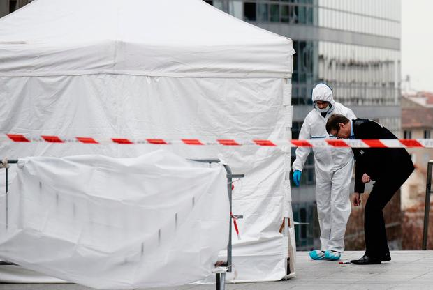 Forensic police at the main entrance of the private Leonard-de-Vinci university in Courbevoie, northwest of Paris, where a 66-year-old teacher was repeatedly stabbed to death. Photo: PHILIPPE LOPEZ/AFP/Getty Images