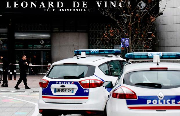 Police block the access at the main entrance of the private Leonard-de-Vinci university in Courbevoie, northwest of Paris, where a 66-year-old teacher was repeatedly stabbed to death. Photo: PHILIPPE LOPEZ/AFP/Getty Images