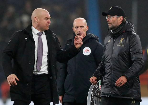 Soccer Football - Premier League - Burnley v Liverpool - Turf Moor, Burnley, Britain - December 5, 2018 Burnley manager Sean Dyche and Liverpool manager Juergen Klopp after the match. REUTERS/Scott Heppell