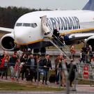 The UK's aviation authority has said it is taking action to force Ryanair to pay compensation to customers. Photo: REUTERS