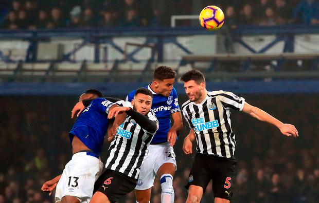 Everton's Yerry Mina (left) and Dominic Calvert-Lewin (second right) battle for the ball with Newcastle United's Jamaal Lascelles (second left) and Fabian Schar (right). Photo credit: Peter Byrne/PA Wire