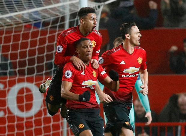 Soccer Football - Premier League - Manchester United v Arsenal - Old Trafford, Manchester, Britain - December 5, 2018 Manchester United's Anthony Martial celebrates scoring their first goal with Jesse Lingard and Nemanja Matic REUTERS/Darren Staples