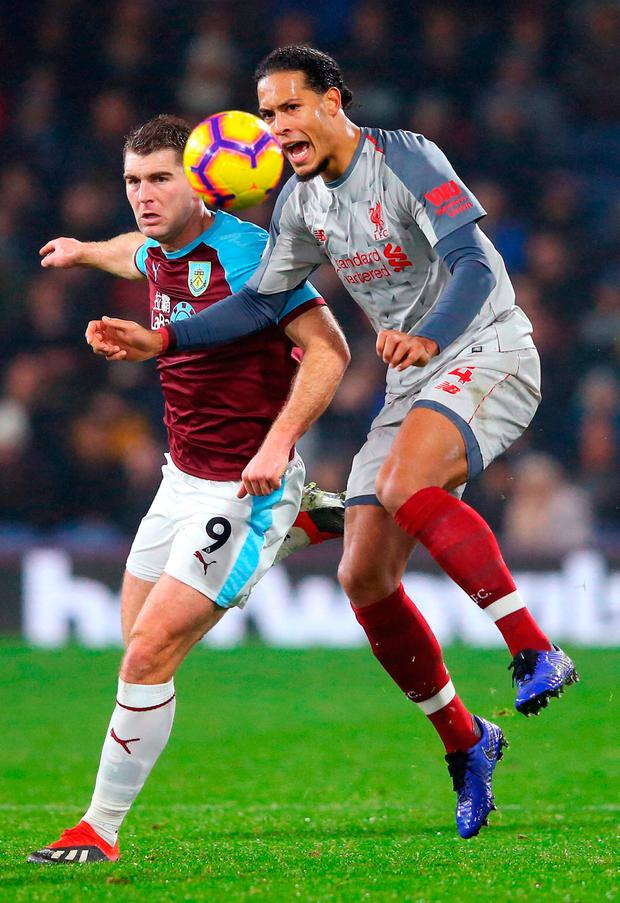 Virgil van Dijk of Liverpool battles for possession with Sam Vokes of Burnley. Photo by Alex Livesey/Getty Images