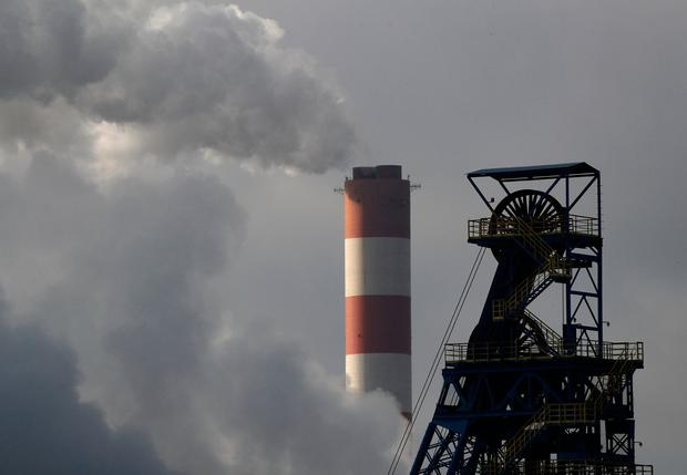 Challenge to environment: Steam billows from the chimney of Laziska Power Station, a thermal power plant, in front of Boleslaw Smialy Coal Mine in Laziska Gorne, near where the COP24 climate change conference is taking place in Katowice, Poland. Photo: REUTERS/Kacper Pempel