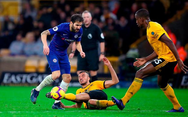 Chelsea's Cesc Fabregas (left) and Wolverhampton Wanderers' Romain Saiss battle for the ball. Photo: Nick Potts/PA Wire