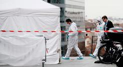 Crime scene: Forensic investigations at the scene of the killing of teacher John Dowling in Paris. Photo: AFP/Getty Images