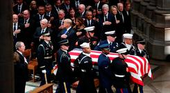 Paying respects: Former US President George H W Bush's coffin is carried past his son former President George W Bush (left), President Donald Trump, first lady Melania Trump, former President Barack Obama, former first lady Michelle Obama, former President Bill Clinton, former first lady Hillary Clinton, former President Jimmy Carter and former first lady Rosalynn Carter. Photo: Reuters/Kevin Lamarque