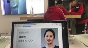 A profile of Huawei's chief financial officer Meng Wanzhou is displayed on a computer at a store in Beijing, China (Ng Han Guan/AP)