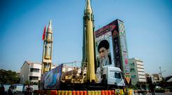 A display featuring missiles and a portrait of Iran's Supreme Leader Ayatollah Ali Khamenei is seen at Baharestan Square in Tehran, Iran September 27, 2017. Picture taken September 27, 2017. Nazanin Tabatabaee Yazdi/TIMA via REUTERS