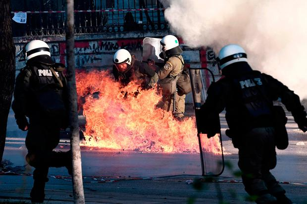 Flashpoint: Petrol bombs explode next to riot police. Photo: AFP/Getty Images
