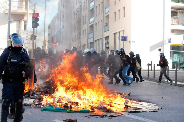 Riots: Trash bins burn as youths clash with police in Marseille. Photo: REUTERS/Jean-Paul Pelissier