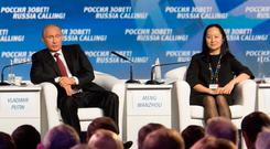 Arrest: Huawei executive Meng Wanzhou with Russia's President Vladimir Putin at an event in Moscow in 2014. Photo: REUTERS/Alexander Bibik