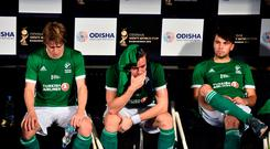 Players of Ireland look dejected following their team's defeat in the FIH Men's Hockey World Cup Group B match between Ireland and England at Kalinga Stadium on December 7, 2018 in Bhubaneswar, India. (Photo by Charles McQuillan/Getty Images for FIH)