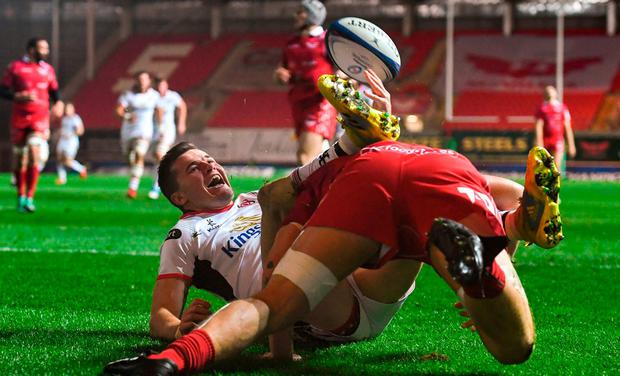 Jacob Stockdale of Ulster celebrates after scoring his side's first try during the European Rugby Champions Cup Pool 4 Round 3 match between Scarlets and Ulster at Parc Y Scarlets in Llanelli, Wales. Photo by Ramsey Cardy/Sportsfile