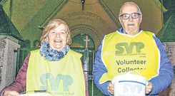 Good cause: Joan Gill and Noel Boyce preparing for the St Vincent De Paul church gate collection at St Bernadette's Church, Clogher Road, Crumlin, Dublin
