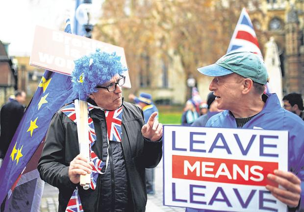 Vote: A Brexit supporter and an anti-Brexit demonstrator at the Houses of Parliament, London, this week. Photo: REUTERS/Henry Nicholls
