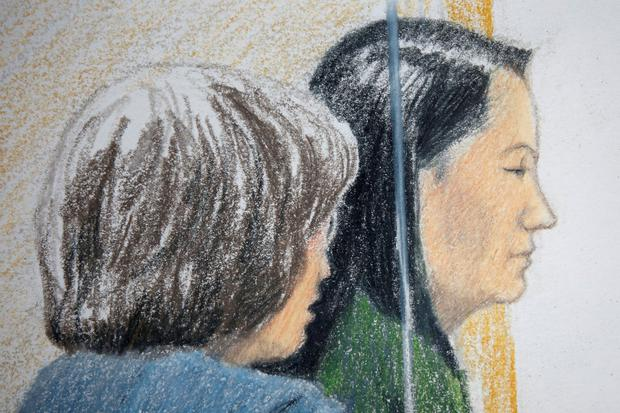 Huawei CFO Meng Wanzhou, who was arrested on an extradition warrant, appears at her B.C. Supreme Court bail hearing along with a translator, in a drawing in Vancouver, British Columbia, Canada December 7, 2018. REUTERS/Jane Wolsak