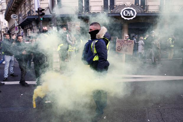 A protester wearing a yellow vest attends a demonstration during a national day of protest by the