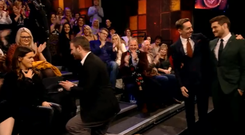 David gets down on one knee to propose to Ashley, while Ryan Tubridy and Michael Bublé look on