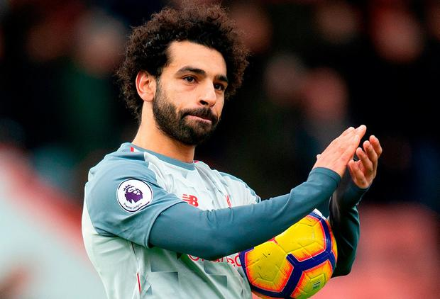 16eb564872e Liverpool s Mohamed Salah applauds the travelling Liverpool fans after the  Premier League match at the Vitality
