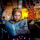 Isobel Conachy (8) enjoying her Christmas Book. Photo: David Conachy.