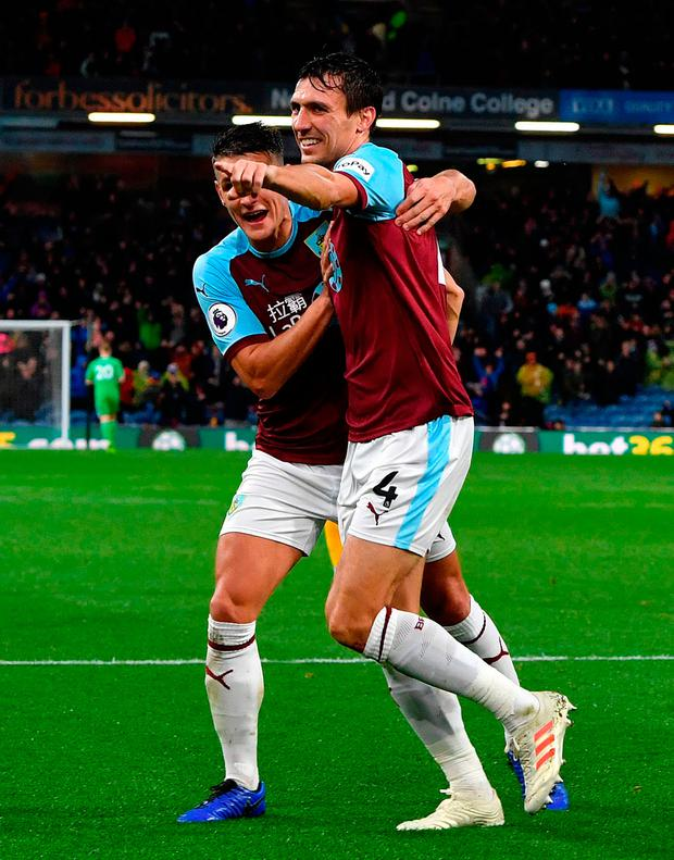 Burnley's Jack Cork celebrates after his shot deflected off team-mate James Tarkowski to give their side the first goal